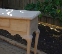 Moulded top, drawers and legs.