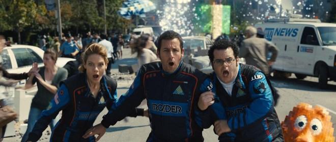 Violet (Michelle Monaghan), Sam Brenner (Adam Sandler), Ludlow (Josh Gad) and Q*bert in Columbia Pictures' PIXELS