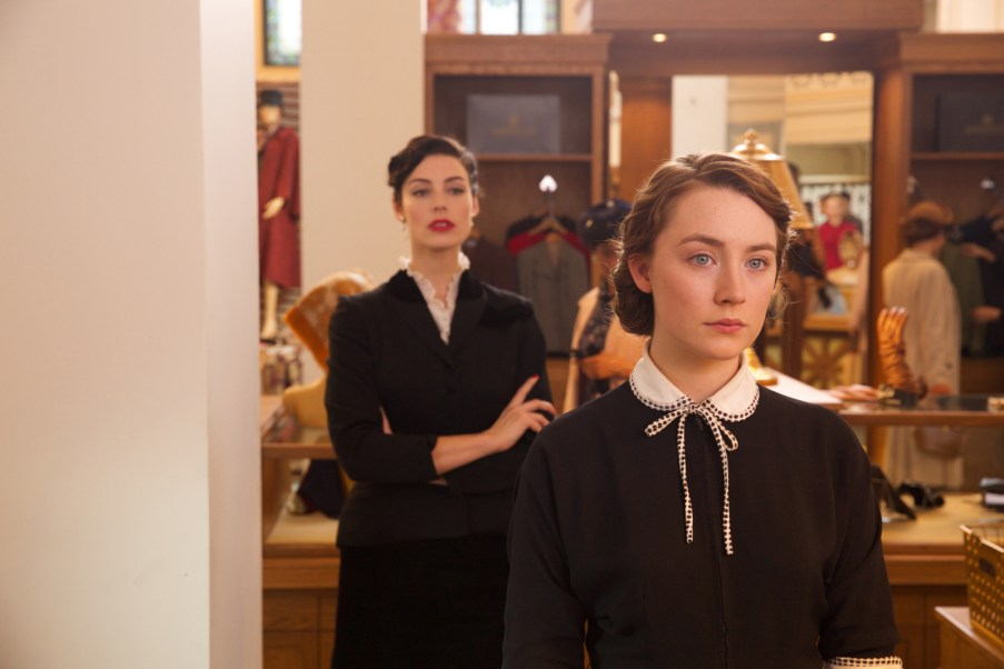 """Jessica Paré as """"Miss Fortini"""" and Saoirse Ronan as """"Eilis"""" in BROOKLYN. Photo by Kerry Brown. © 2015 Twentieth Century Fox Film Corporation All Rights Reserved"""