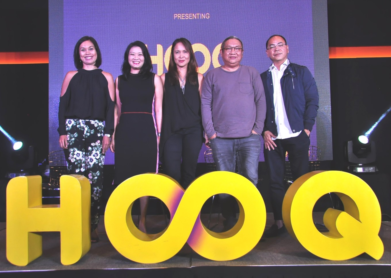 HOOQ Team- Sheila Paul, Marketing Head, Allison Chew Regional Brand and Communications Head, Jane Cruz-Walker, Country Manager and Jeff Remigio Programming and Content Head with one of t