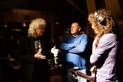 "L-r, Brian May, Producer Graham King and Gwilym Lee on the set of Twentieth Century Fox's ""Bohemian Rhapsody."""