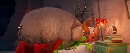 The Grinch (Benedict Cumberbatch, center) gets more than he bargained for after he captures a lackadaisical reindeer named Fred (left) to help pull his sleigh, and learns that Fred would much rather snuggle with the Grinch and dog Max (right) in Dr. Seuss' The Grinch from Illumination.