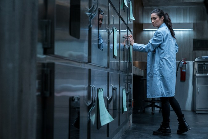 Megan (Shay Mitchell) realizes that something is not right in Hanna Grace's cadaver drawer in Screen Gems' THE POSSESSION OF HANNAH GRACE.