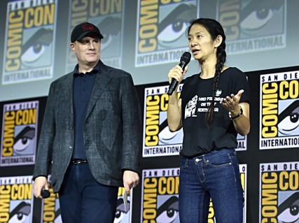 SAN DIEGO, CALIFORNIA - JULY 20: President of Marvel Studios Kevin Feige and director Chloe Zhao of Marvel Studios' 'The Eternals' at the San Diego Comic-Con International 2019 Marvel Studios Panel in Hall H on July 20, 2019 in San Diego, California. (Photo by Alberto E. Rodriguez/Getty Images for Disney)
