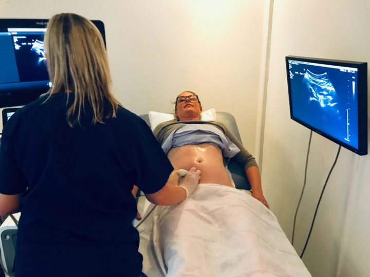 Angie White performing a sonogram on Lindsey Dietz at The Whiteley Clinic