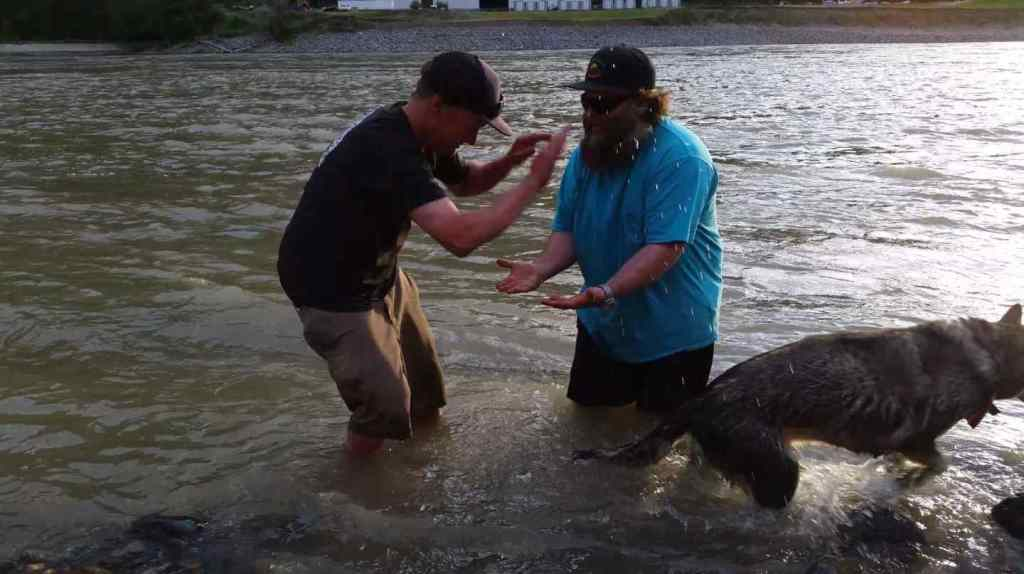 Sharing high fives after landing a nice Sturgeon