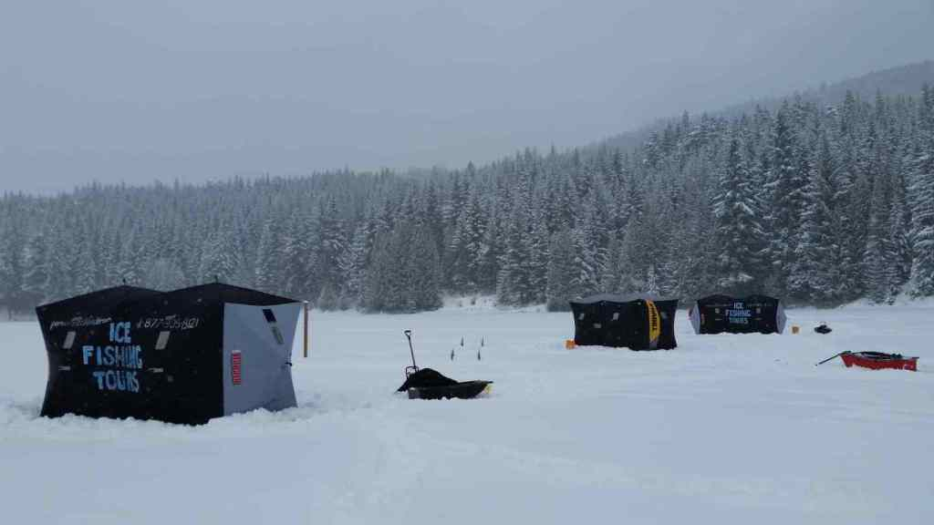 Ice fishing huts set up on Lost Lake in Whistler BC