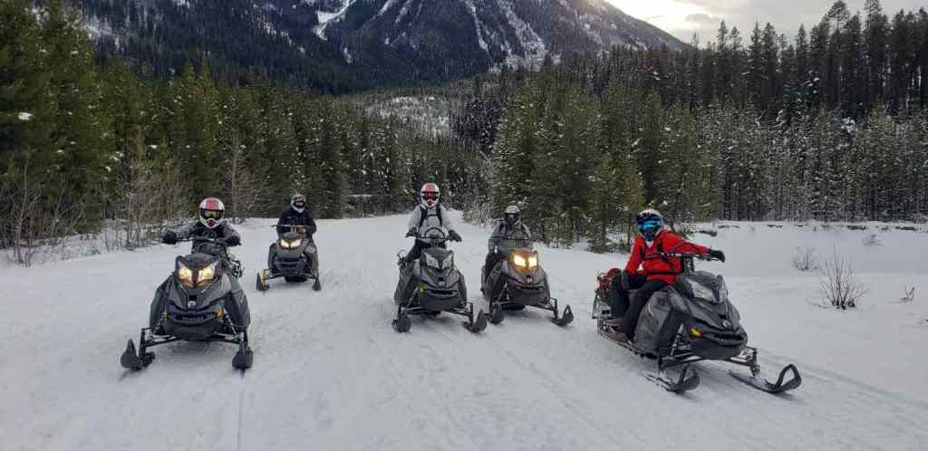 Ice fishing with Snowmobiles in British Columbia Canada