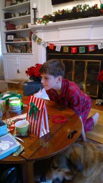 Adam waiting to open his gifts