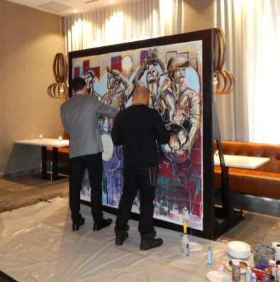 John Hairston paints with a guest.