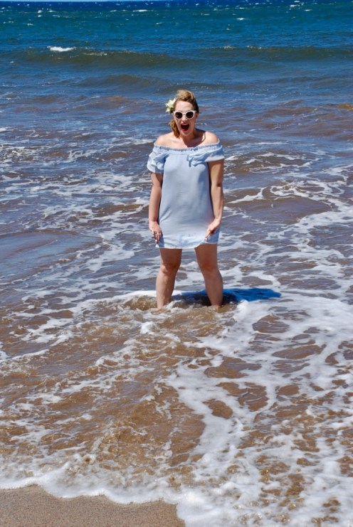 A gorgeous off-the-shoulder blue dress perfect for date night dinner or playing in the surf