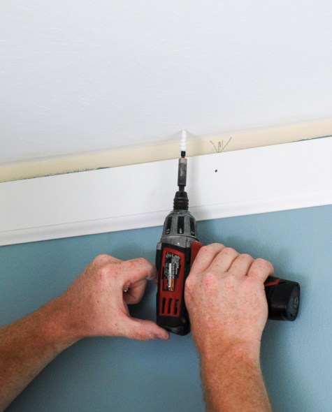 Set anchors to secure DIY crown molding to ceiling