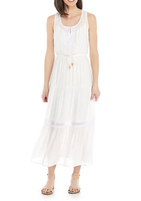 Woman wearing a white eyelet maxi dress