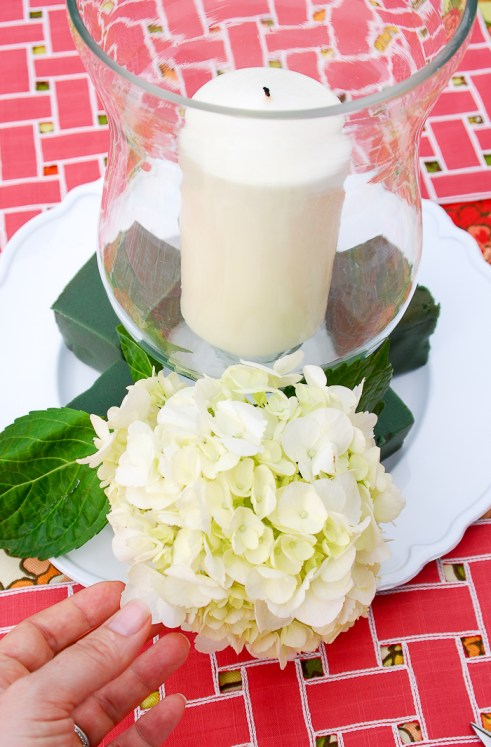 Step 5 to create hydrangea centerpiece - cut stems down and stick in floral foam