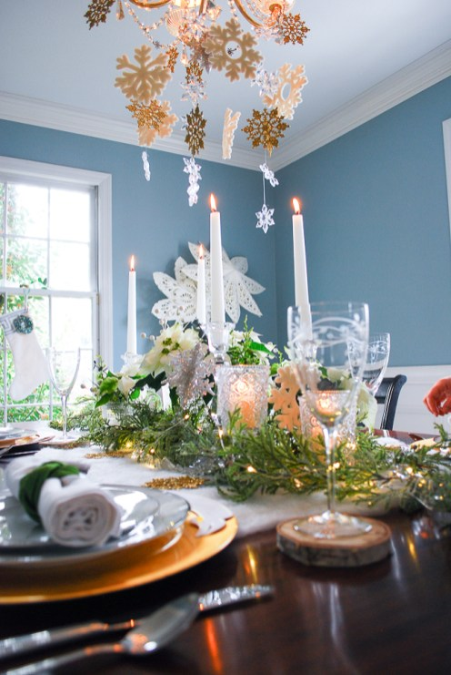 Winter tablescape tutorial for a frosted forest tablescape in green, gold, and white with poinsettia, snowflakes, birch, and cedar garland