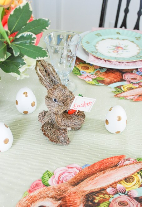 Little straw bunny surrounded by polkadot Easter eggs for a bit of whimsy on this Easter brunch table