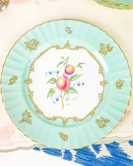 Royal Worcester fruit plates with mint green border and central sprig of peaches and blue bell flowers
