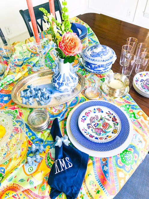 Colorful table setting with blue and white and paisley table cloth illustrating 5 summer table styling tips
