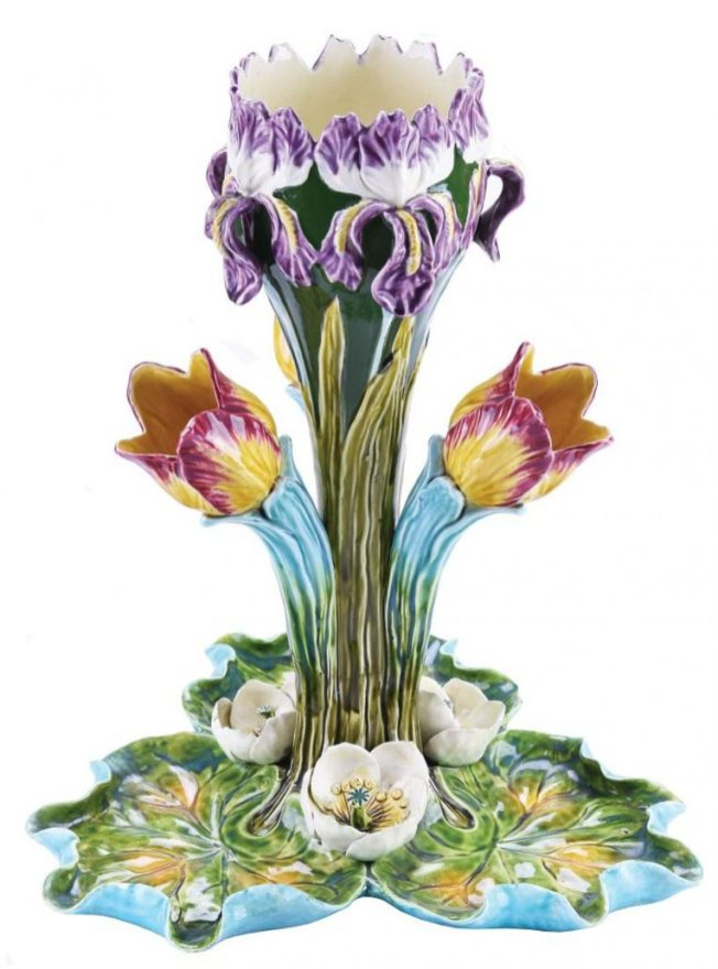 Ceramic centerpiece with iris and tulip forms.