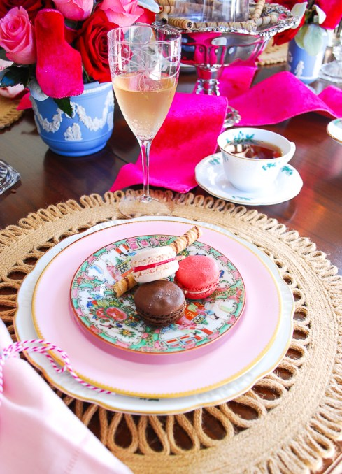 Three tasty macarons served on rose medallion plate