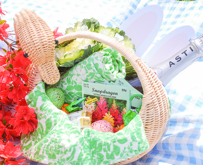 Create an adult Easter basket for friends and fill it with favorite champagne, pretty dish towels, flower seeds, and candy.