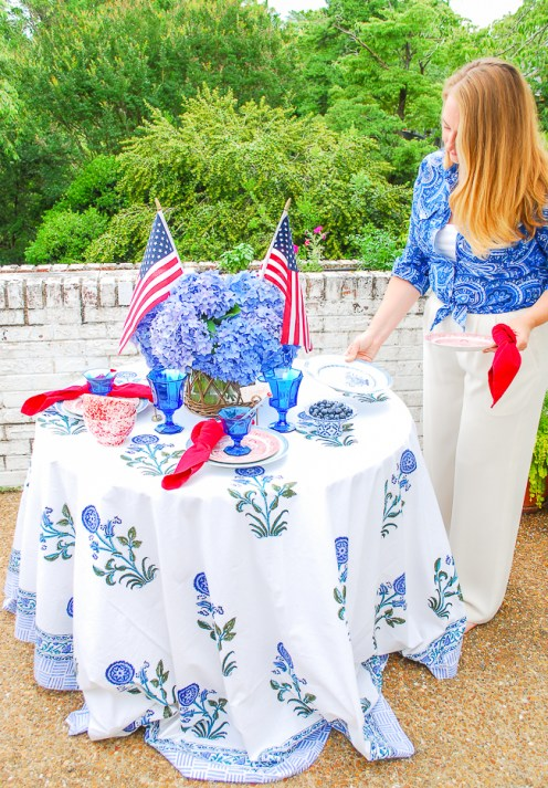 Katherine sets patriotic table with red and blue china, Fostoria goblets, and hydrangea centerpiece