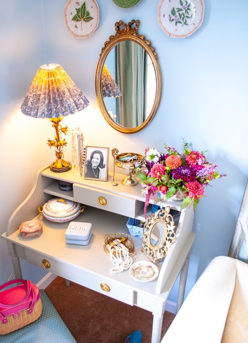Vintage vanity styled with gilt mirror, tole floral lamp, and jewelry boxes