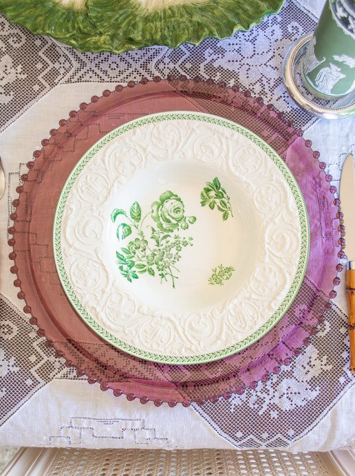 Wedgwood Patrician Robert soup bowls on a purple glass charger and white lace tablecloth