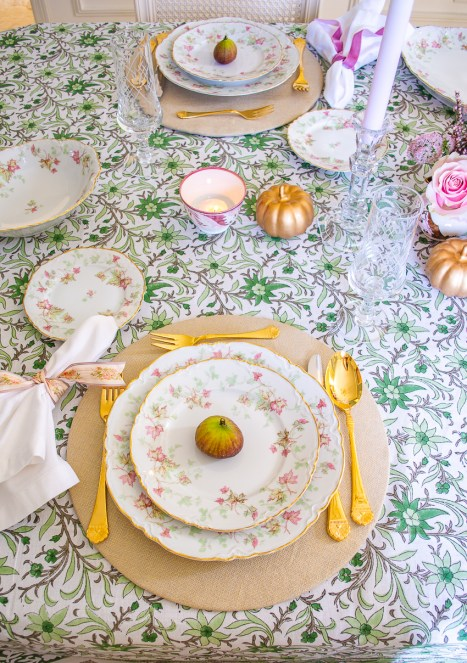 Hutschenreuther Bavarian china on green and white Indian block print tablecloth with gold flatware and linen napkin