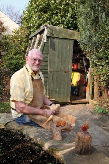 Ken Smith outside his garden worshop