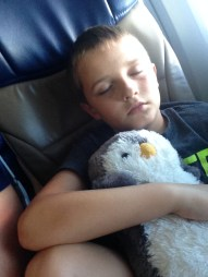 Patrick sleeping on the airplane.