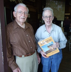 Author Henry E. Bender Jr. presents one of the first copies of his book on railroad depots to Don C. Douglas, to whom the book is dedicated. Douglas worked for the Southern Pacific for many years, including on the Caltrain corridor. He worked jobs ranging from train-order operator and tower man to clerical positions to keep trains running safely and customers happy.  Douglas has also written extensively about railroading. (Janet McGovern photograph)