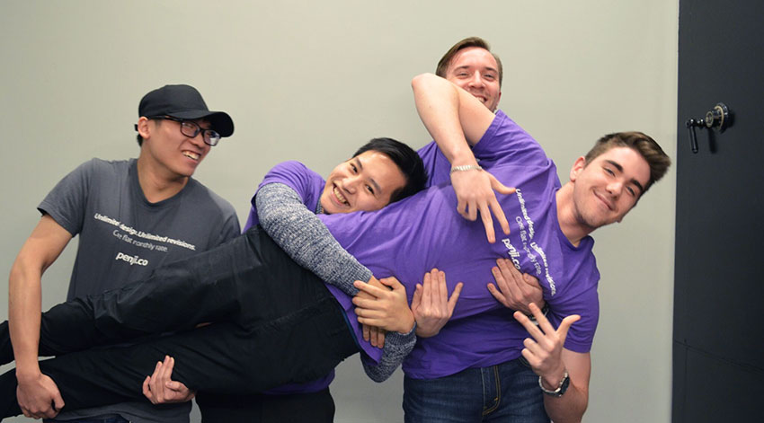 team holding up designer