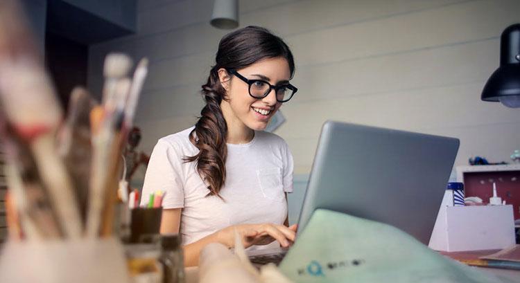 freelancer happy looking at computer