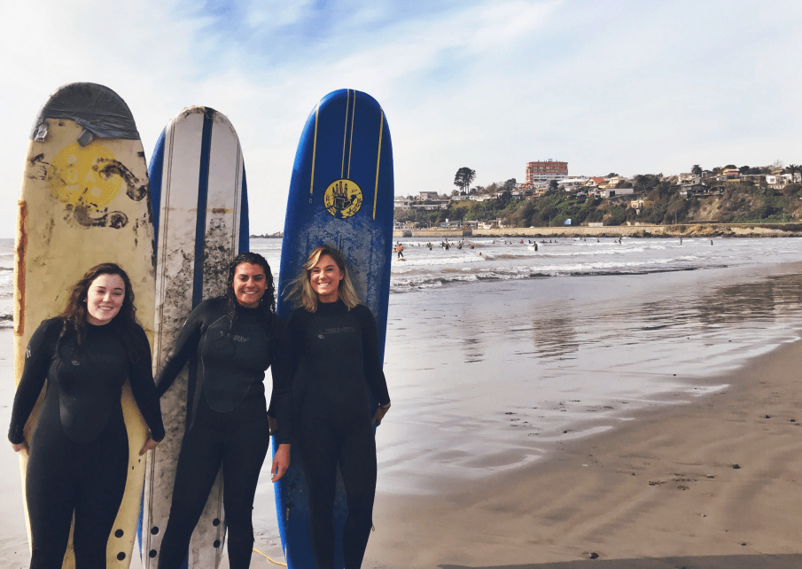 Caption: Left to right: Cailey Cotter, Brianna Camara and Kathryn Limerick surfed off the coast of Chile.