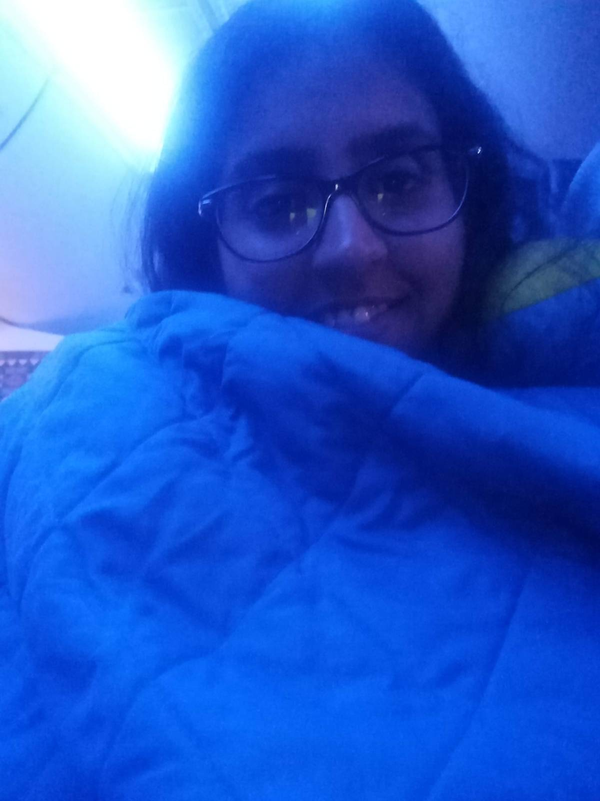 Cozying up in the blanket :D