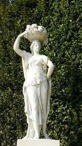 Priestesses Statue with basket of fruit  in Schonbrunn Gardens in Vienna, Austria