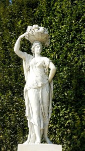 Priestesses Statue with basket of fruit  in Schonbrunn Gardens in Vienna, Austria