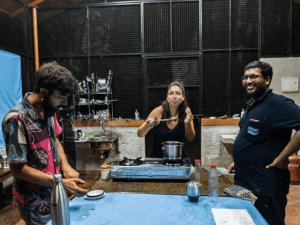 volunteers cooking their own food