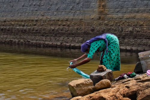 A local person doing laundry in the waters of Chengulam Dam