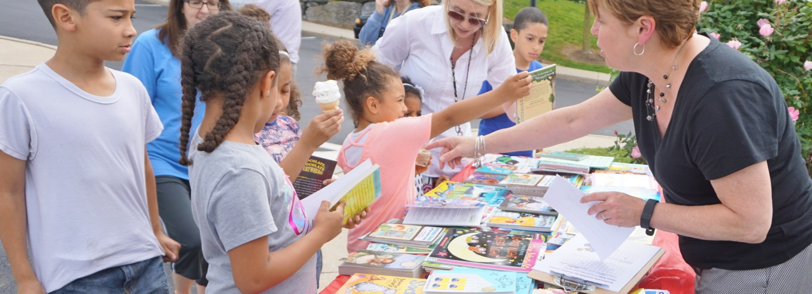 New Literacy Outreach distributes books to children in their neighborhoods