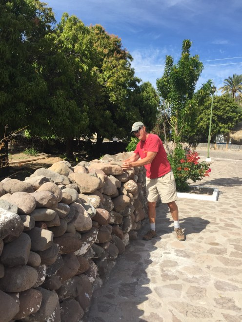 Larry contributing to an old and very long rock wall at San Javier Mission!