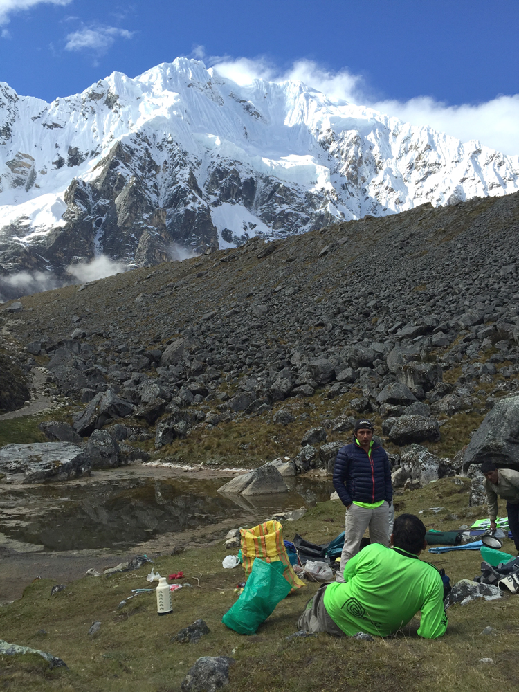 """""""Green Machine"""" staff relaxing after lunch at the base of Salkantay Peak."""