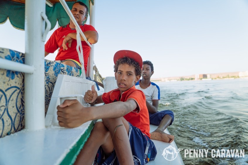 These kids paddle-boarded up to our boat to sing songs for tips.