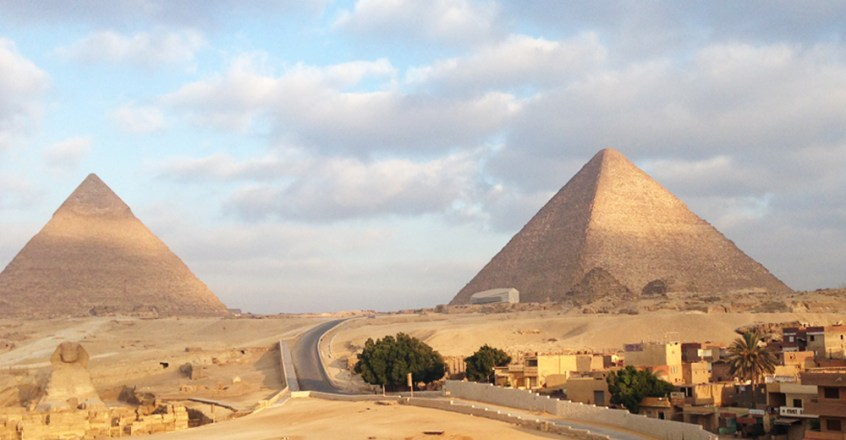 Sunrise over the pyramids from the rooftop terrace.