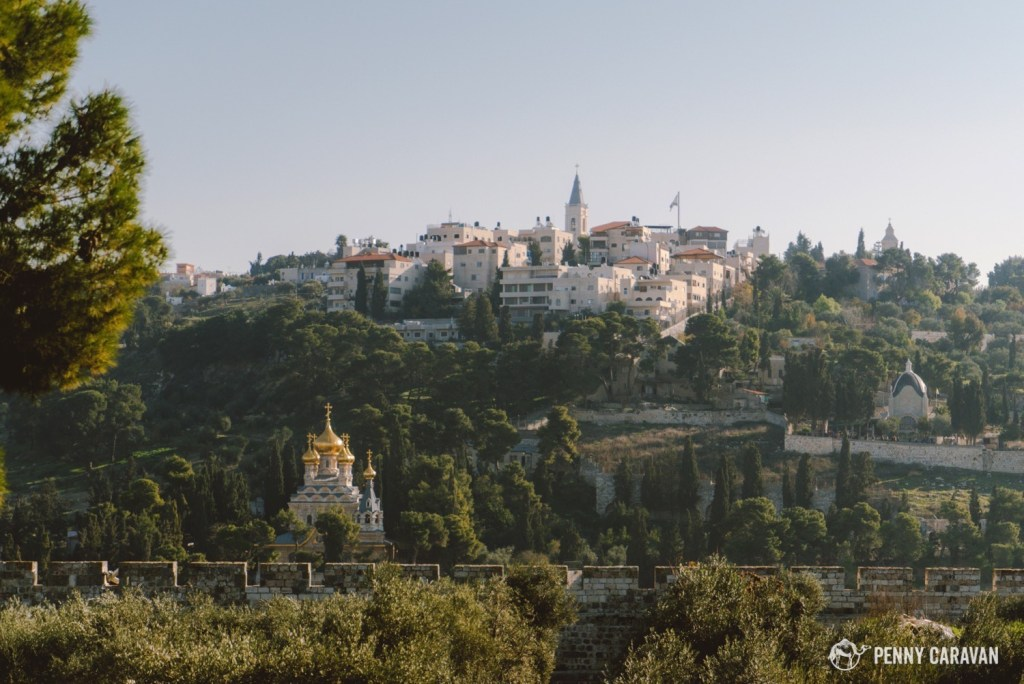 The golden domes of the Church of Mary Magdalene are on the bottom left. The steeple of the Russian Church of the Ascension is the highest structure on the Mount of Olives. Also visible in this photo is the Church of Dominus Flevit, middle right.