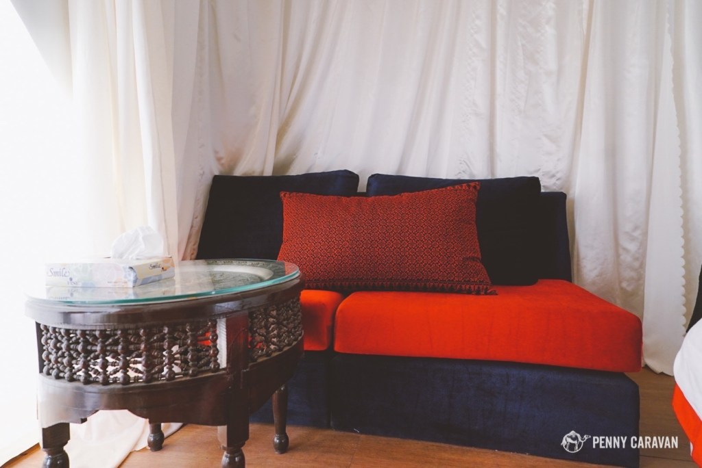 Small seating area inside the tent.