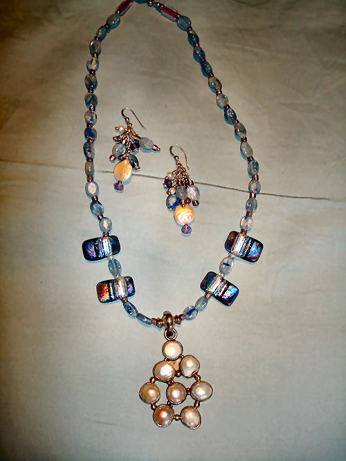 Fresh water pearls set in sterling silver with glass beads and pearls