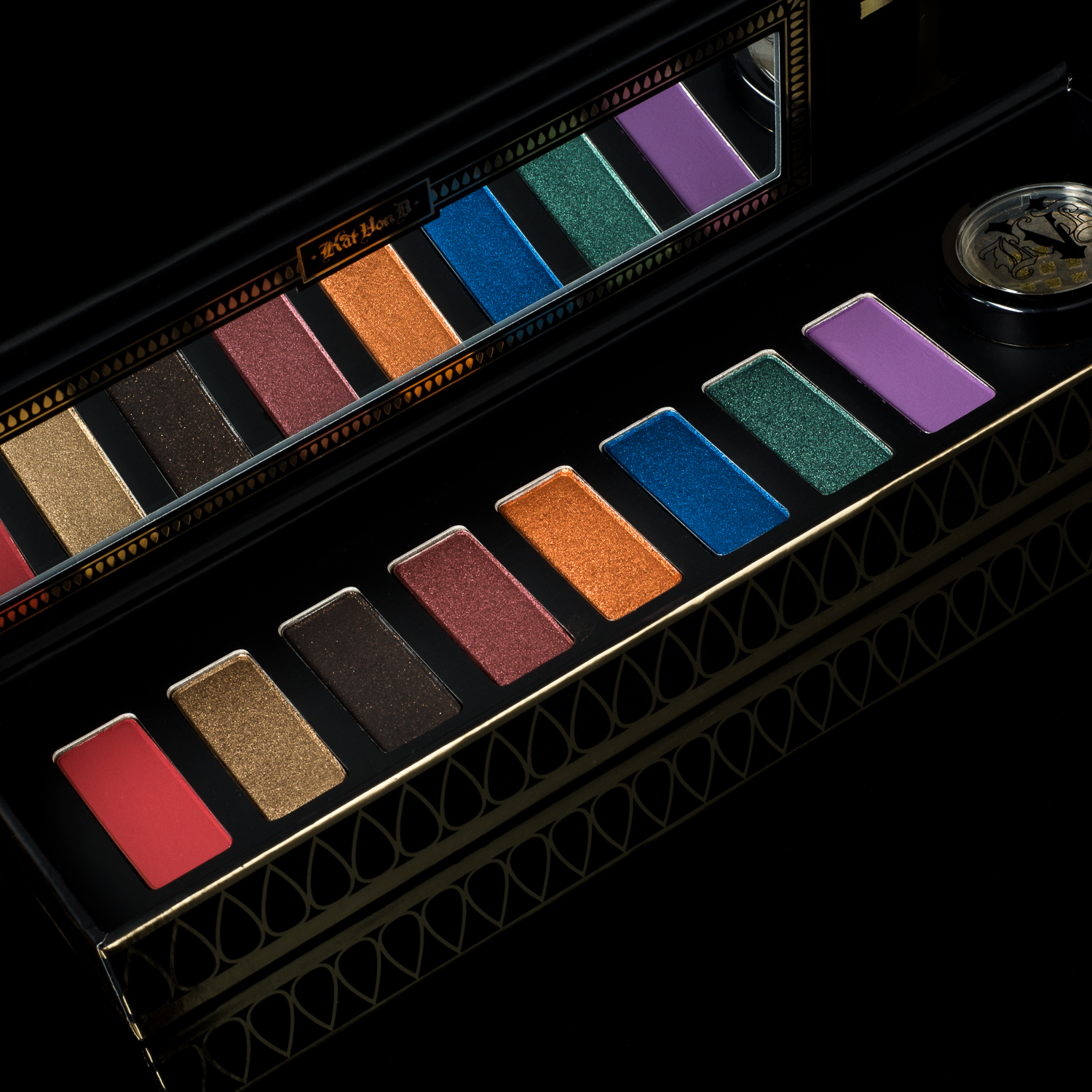 Kat Von D Beauty Serpentina Eyeshadow Palette on a black background