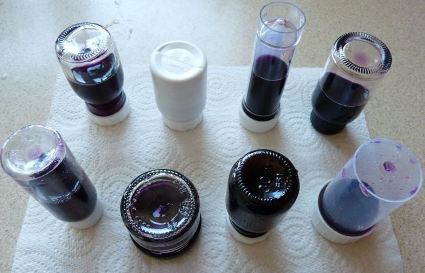 Ink bottles upended